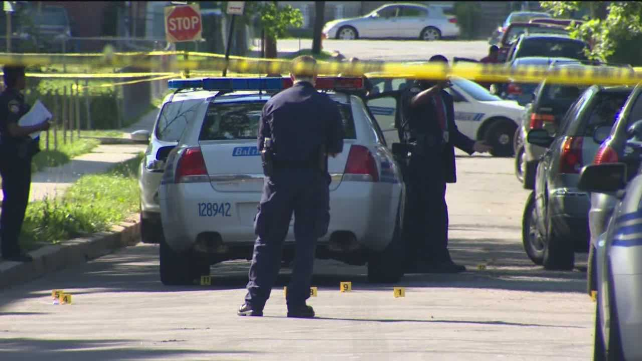 A shootout with police on a neighborhood street in northwest Baltimore leaves one man dead and another on the run.