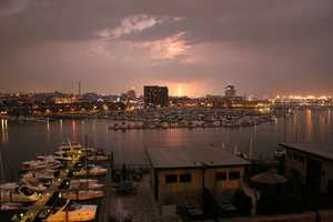 Lighting can be seen in the distance over Baltimore.