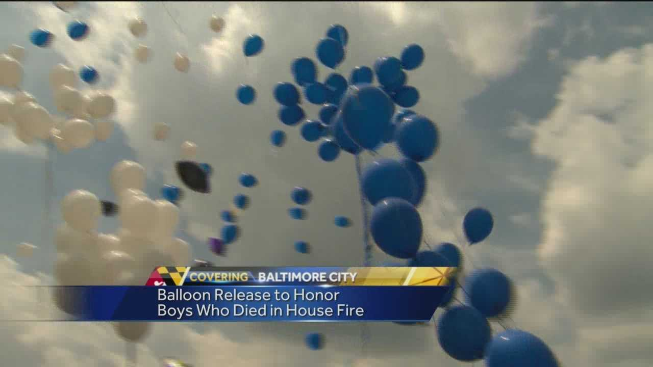 Family and friends release balloons in honor of Decerio Coley and Sean McCullough, who died in a fire earlier this month.