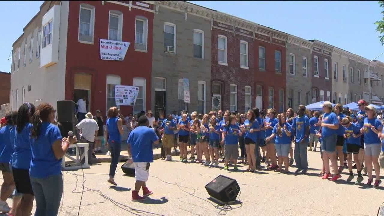 A Baltimore family receives a new home for free in the 1700 block of East Federal Street thanks to Adopt A Block.