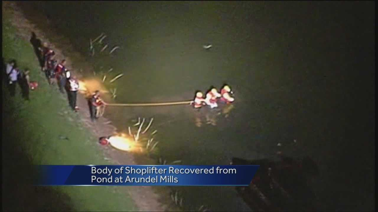 Police said the body of an alleged Arundel Mills Mall shoplifter was recovered in a nearby sediment pond Monday night.