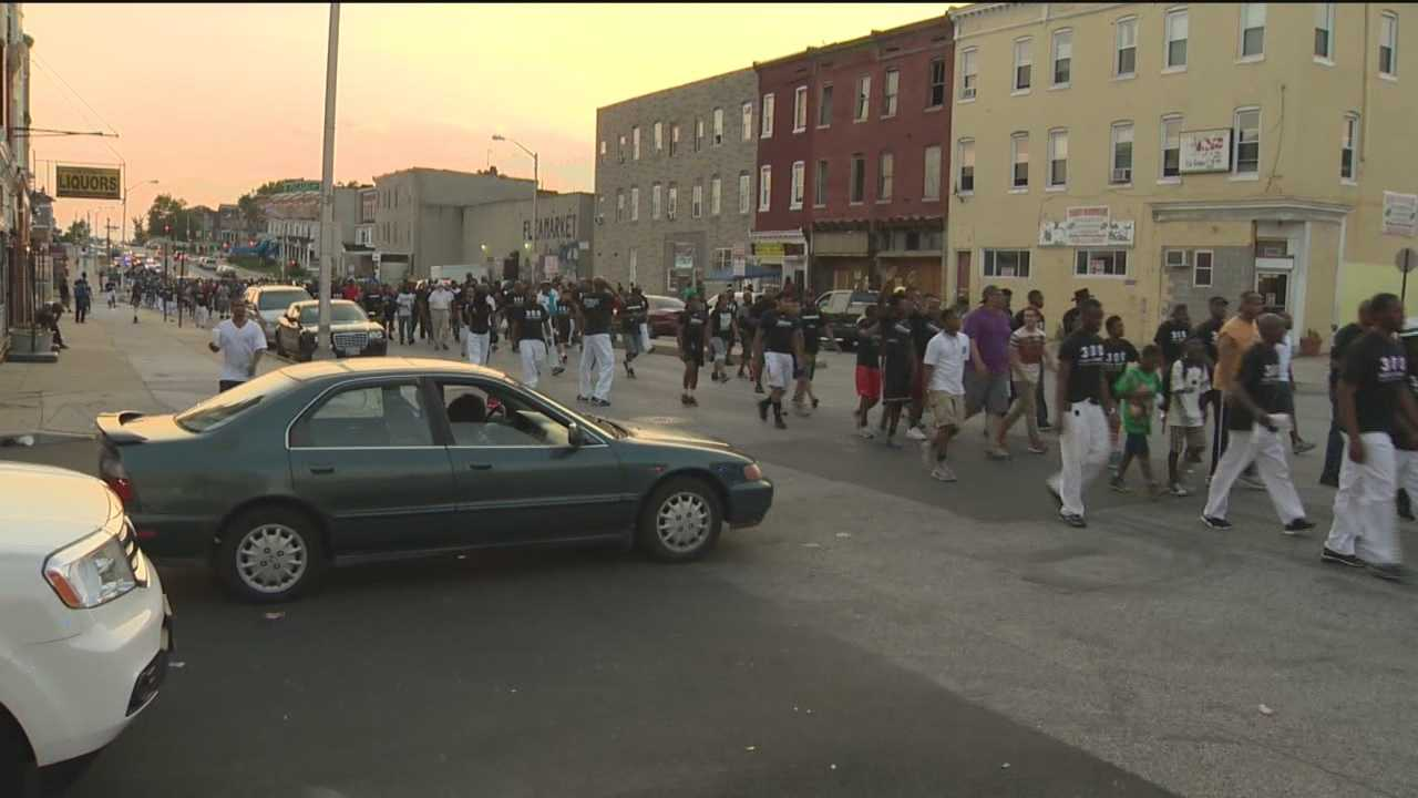 Hundreds of men march down North Avenue in unity against violence in Baltimore City.