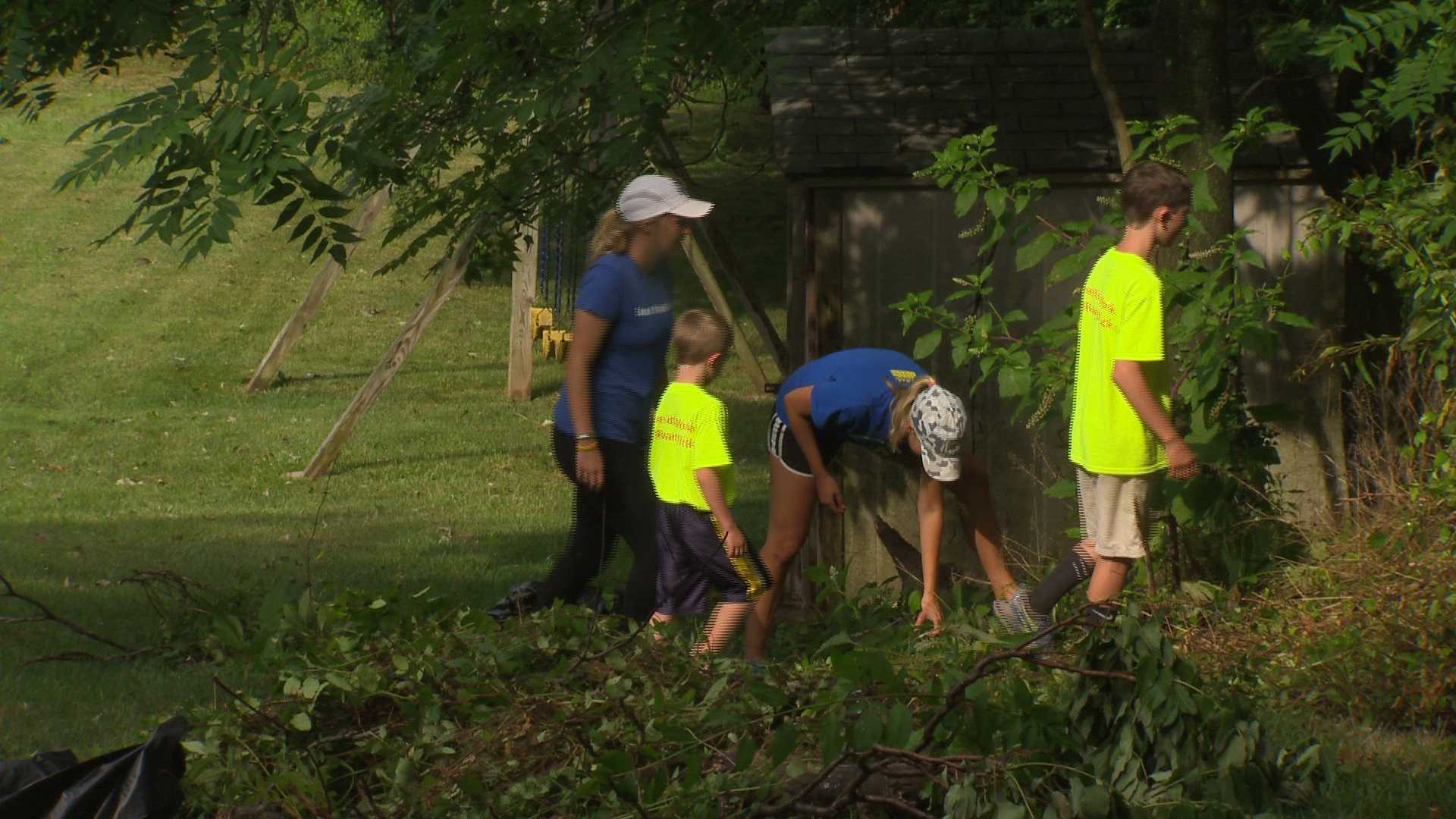 The Murset family helps with chores in Elkridge as a way to pay it forward.