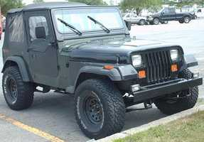 Megan's first car was a 1995 Jeep Wrangler. Hers was green and didn't have air conditioning!