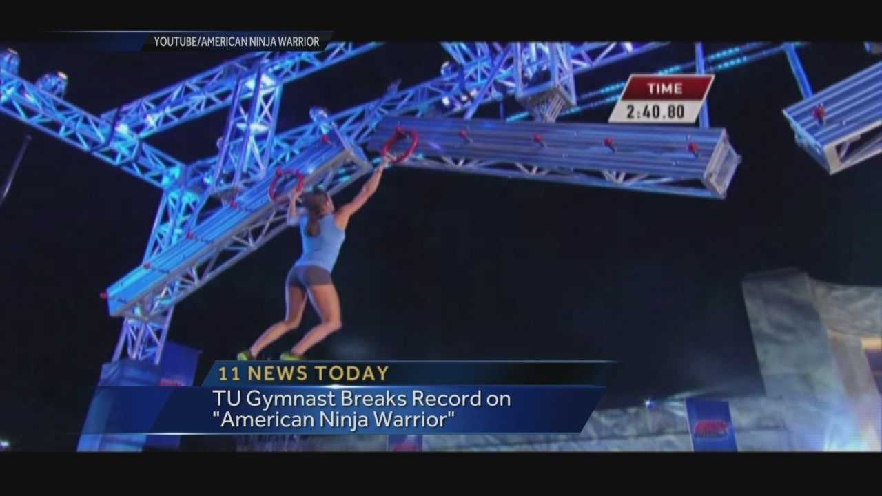 "A tiny Towson University gymnast breaks a record on NBC's popular ""American Ninja Warrior"" show."