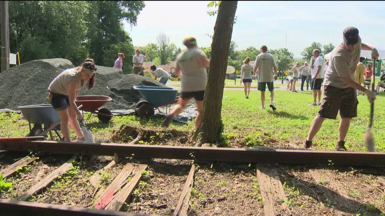 Volunteers worked on 150 feet of the track and for them, the work was a labor of love.