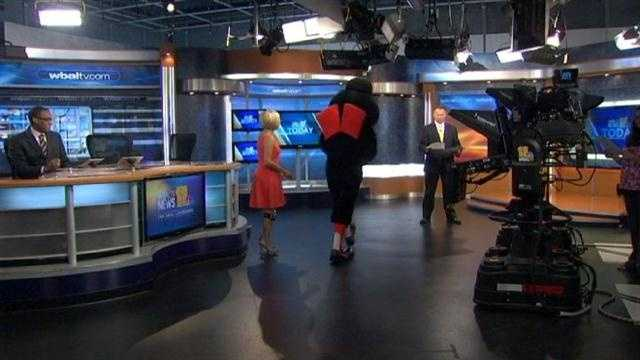 The Baltimore Orioles bird pays a special visit to WBAL-TV 11 with pie in hand ...