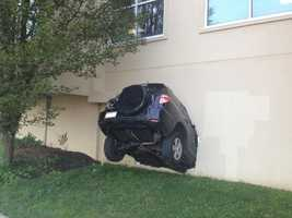 This SUV got lodged into a building on York Road in Towson. Read more here.