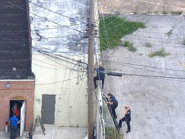 Police have not said how the man made it onto the roof or what he did that made officers chase him. Here, officers can be seen trying to get to the roof to help the officer with the suspect.
