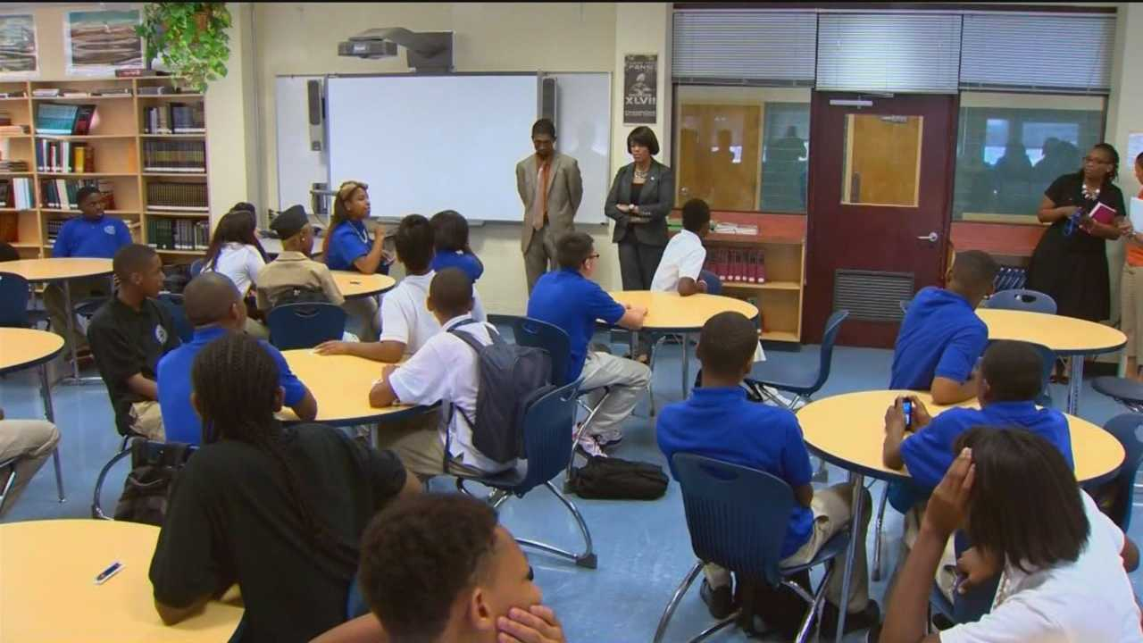 Baltimore's mayor and new schools CEO meet with parents to head off truancy before the school year starts.