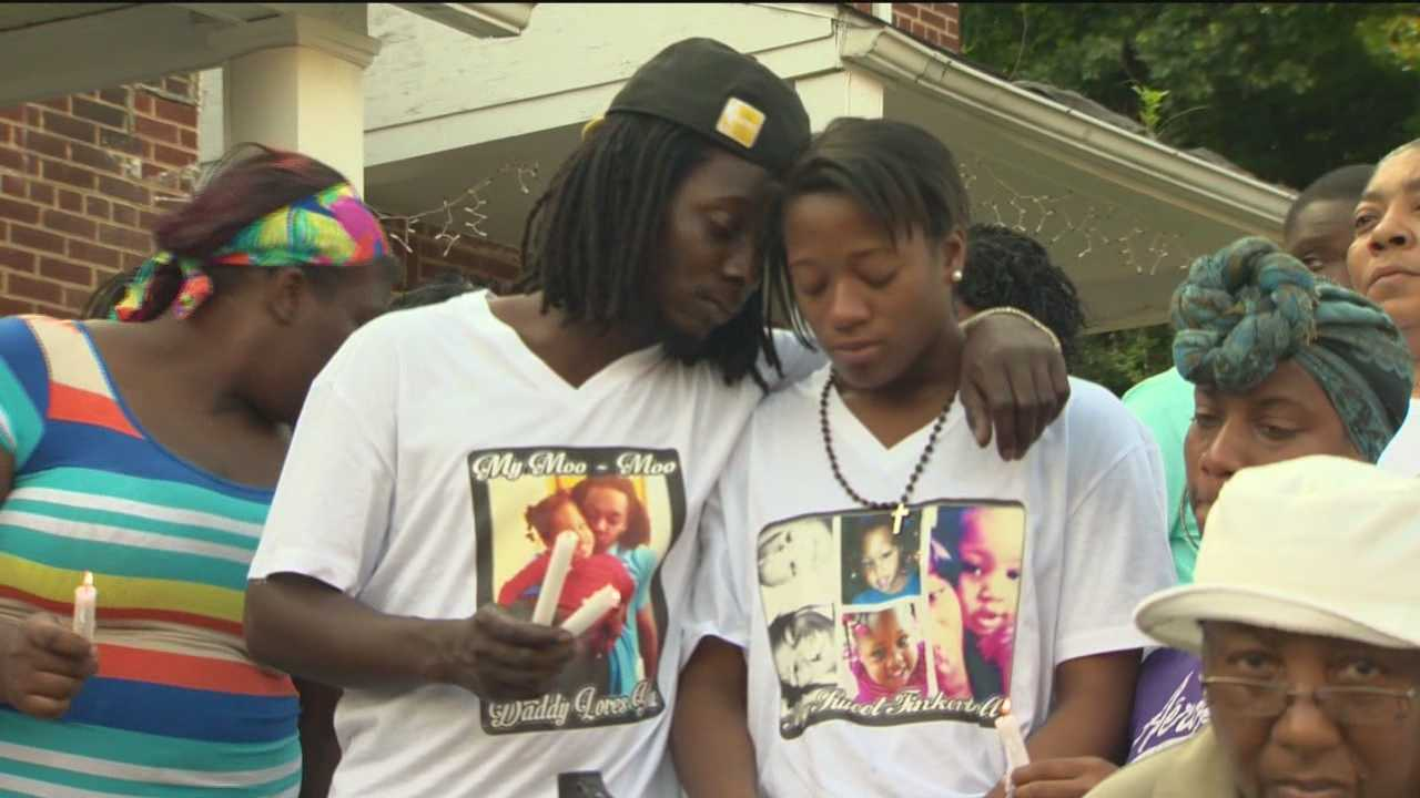 Family, friends and neighbors of McKenzie Elliott gathered Wednesday in Baltimore's Waverly section to mourn the 3-year-old who was killed by a stray bullet last week.