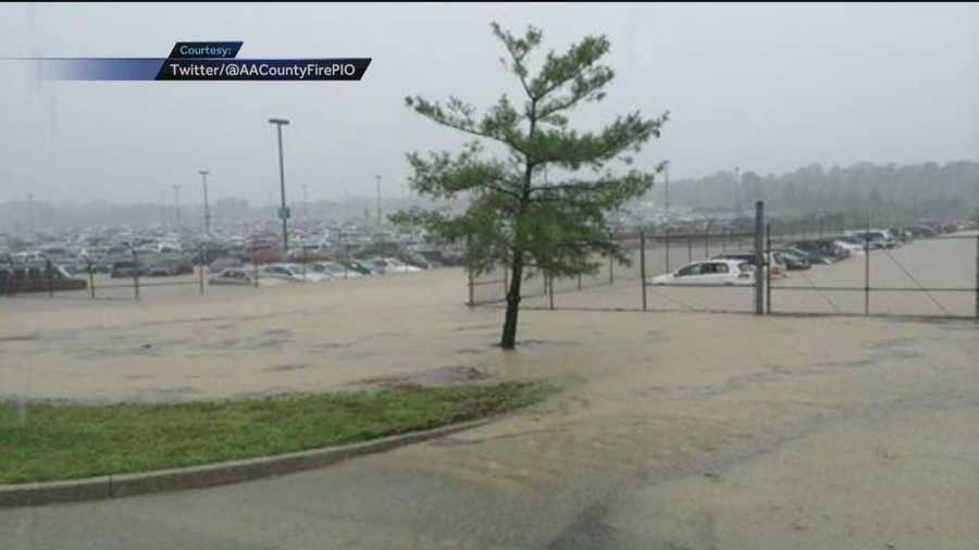 Anne Arundel County fire officials tweeted a photo that shows water as high as the car tires in some spots in the BWI-Marshall long-term parking lots.