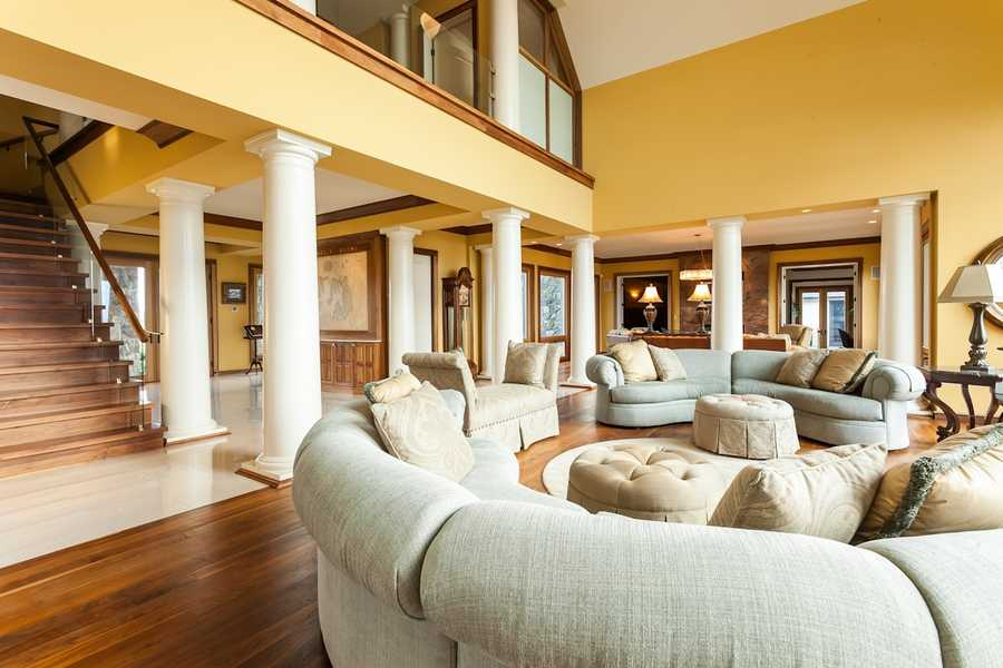 Other rooms include a home office with built-in mahogany shelves&#x3B; a fully-equipped gym&#x3B; a game room with a pool table&#x3B; an observatory with wrap-around windows facing the bay, and an attached three-car garage.
