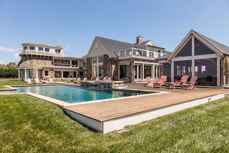 Three-property estate overlooks 1,000 feet of shoreline and has a private sandy beach and pier on the Chesapeake Bay.