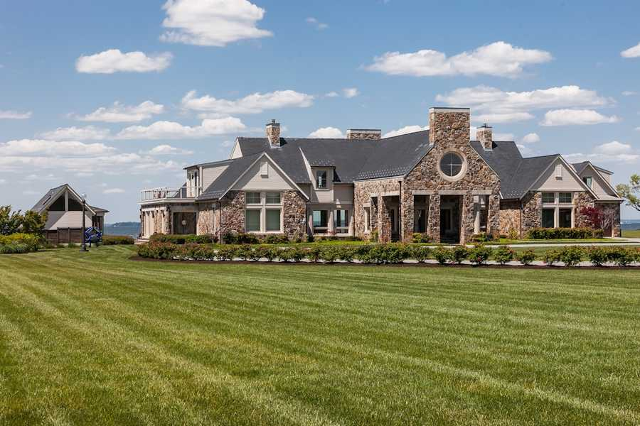 Set back from the road and marked by an electronic gated entrance, Conquest Manor comprises three properties: the main 14,000-square-foot home&#x3B; a 6,200-square-foot guest home with a car showroom&#x3B; and a 1,000-square-foot pool house.
