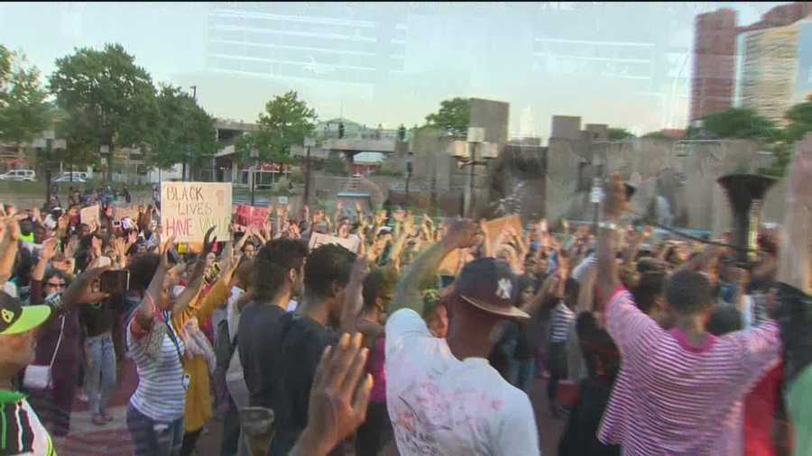 Dozens of people march through Baltimore in a solidarity rally for Michael Brown, the teen killed by police in Ferguson, Missouri.