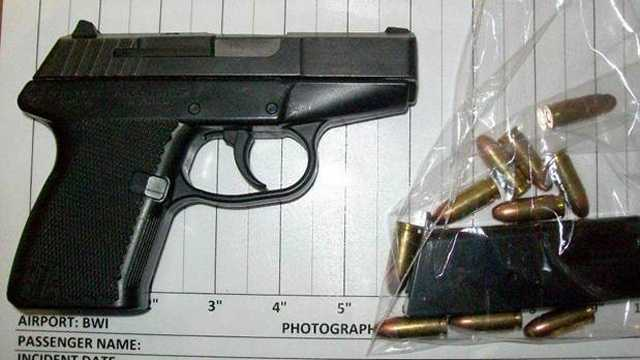 TSA officials say a Prince George's County man tried to bring this stolen gun and ammunition through a security checkpoint at BWI.