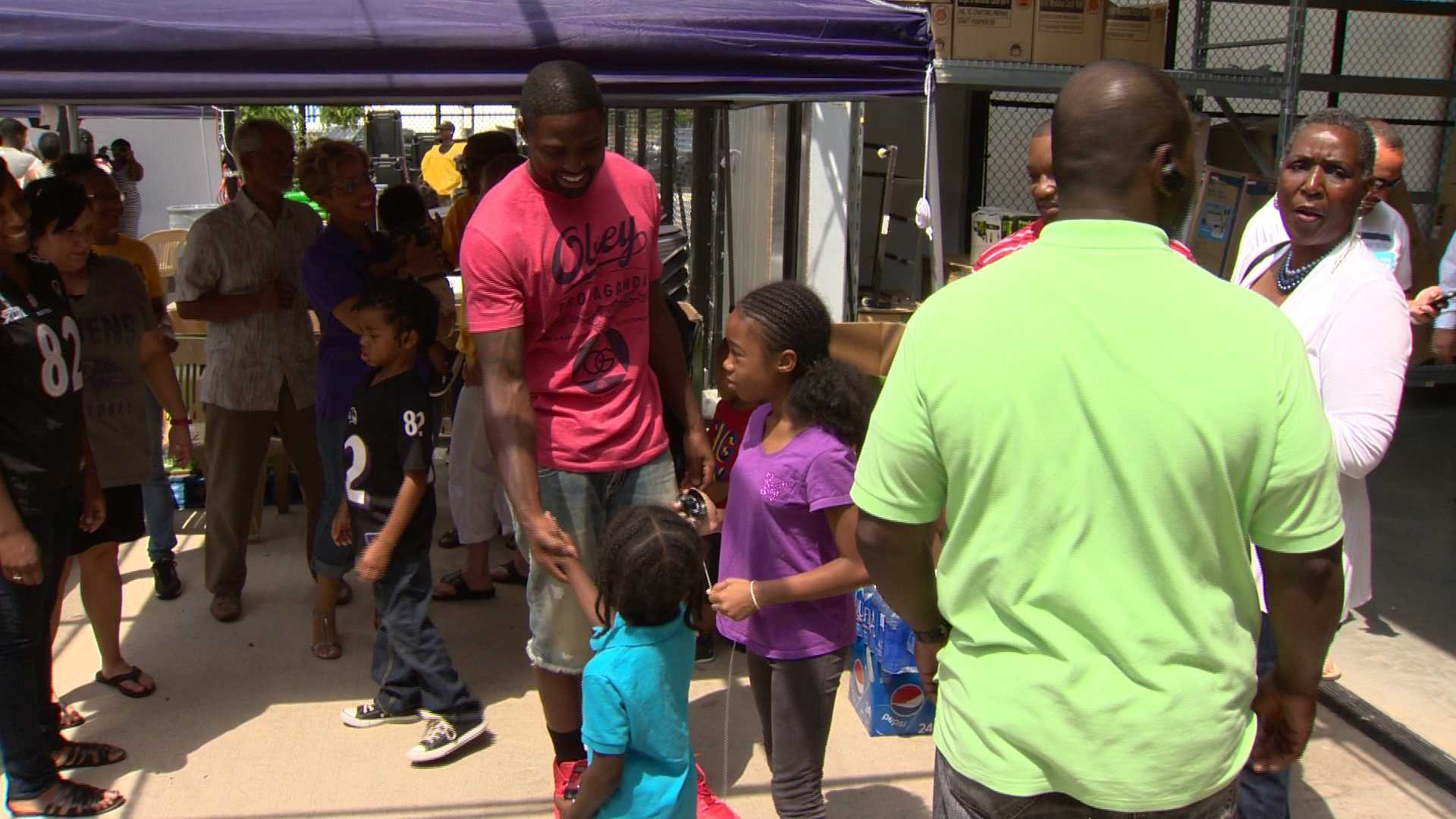 Torrey Smith greets kids at a back-to-school drive