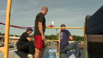 Three area police officers and one soon-to-be state's attorney agreed to spend the weekend on top of the Dunkin Donuts along Route 140 in Westminster as part of the fifth annual Cops on Rooftops fundraiser.
