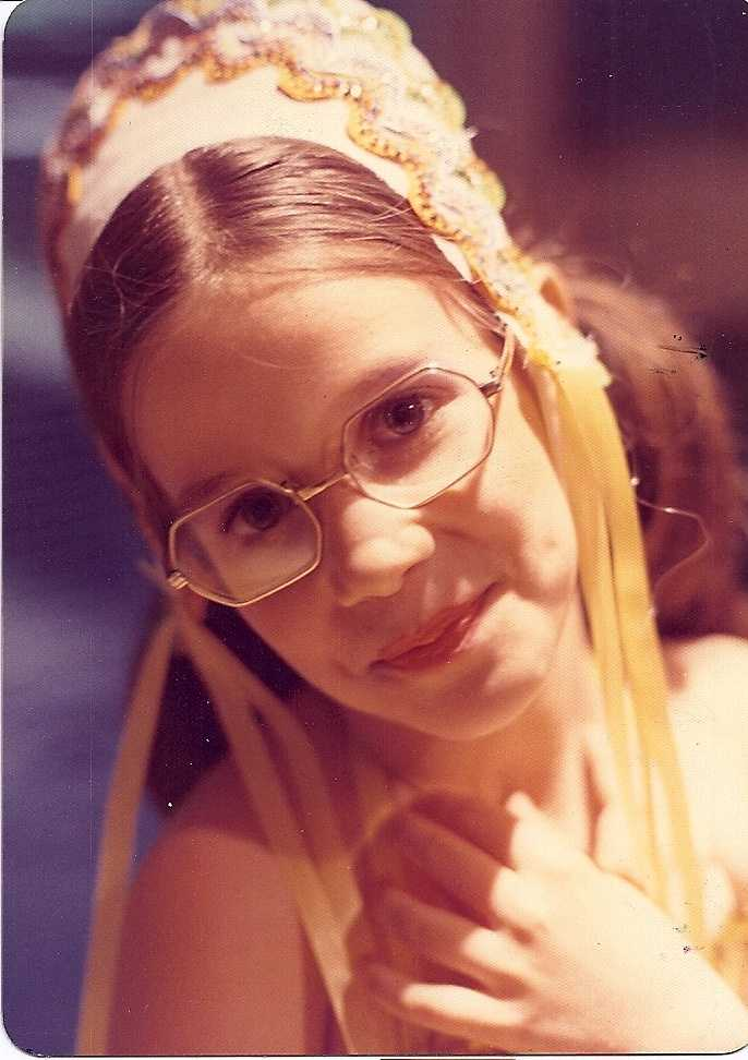At 7, this is Deborah with her first pair of glasses, and a short-lived attempt at dancing.