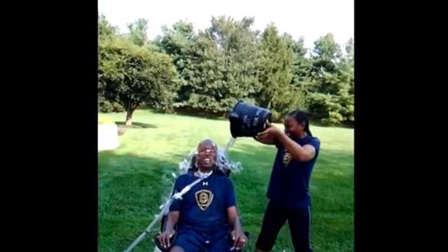 O.J. Brigance's wife, Chanda, helps him take the ALS Ice Bucket Challenge.