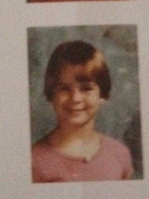Megan Pringle shows off her short hair in this second-grade photo.