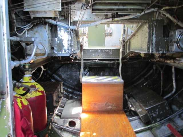 Under the pilot's deck. This is what the bombardier had to crawl under to get to the nose turret.