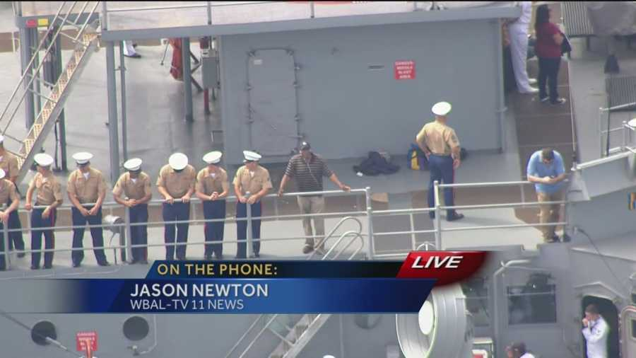 11 News anchor Jason Newton talks with some of the sailors aboard the USS Oak Hill, which is heading into the Inner Harbor sometime this afternoon.