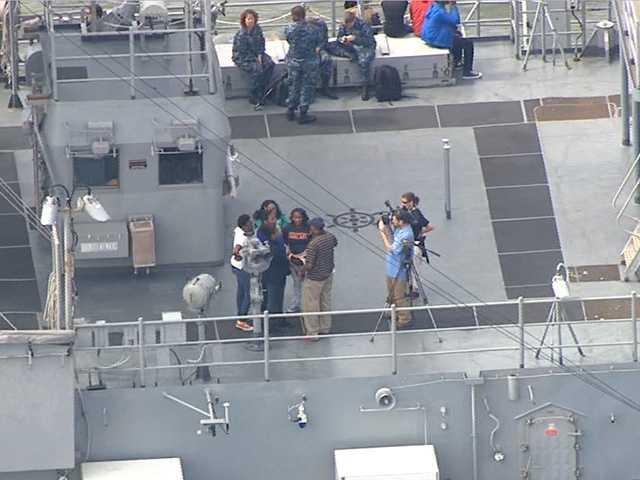 Jason Newton interviews guests on the USS Oak Hill.