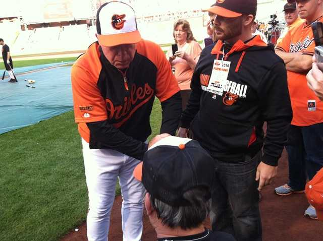 Sept. 16: Orioles Manager Buck Showalter with fans