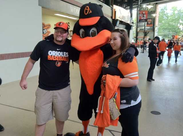 Sept. 16: Fans pose with the Oriole bird