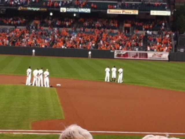 Sept. 16: Players stand for the national anthem.