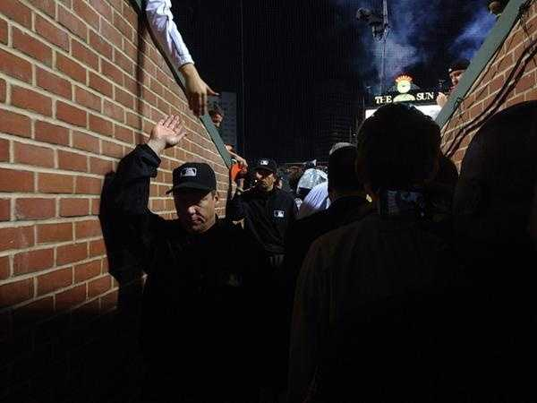 Sept. 16: Orioles fans are so happy about winning the AL East, even the umpires are getting high fives