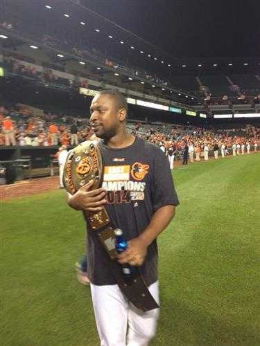 Sept. 16: Delmon Young with the championship belt.