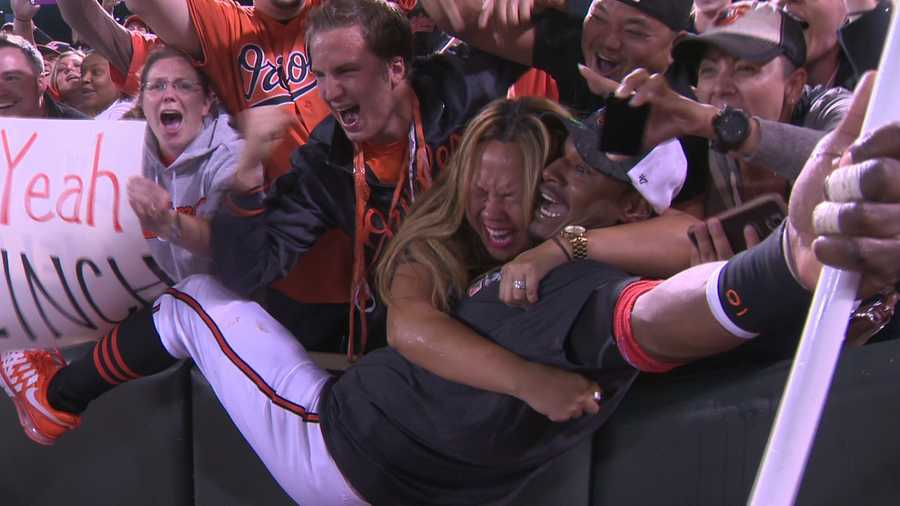 Adam Jones jubilant with fans after the O's clinch the playoffs.