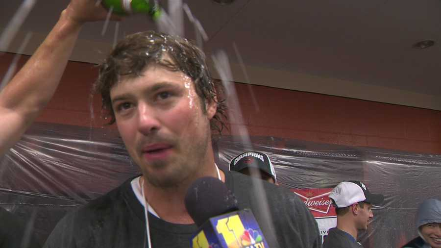 Pitcher Andrew Miller is coated in champagne as he talks to 11 Sports.