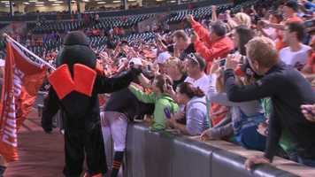 The Oriole bird joins in with Jones during his celebration with fans.