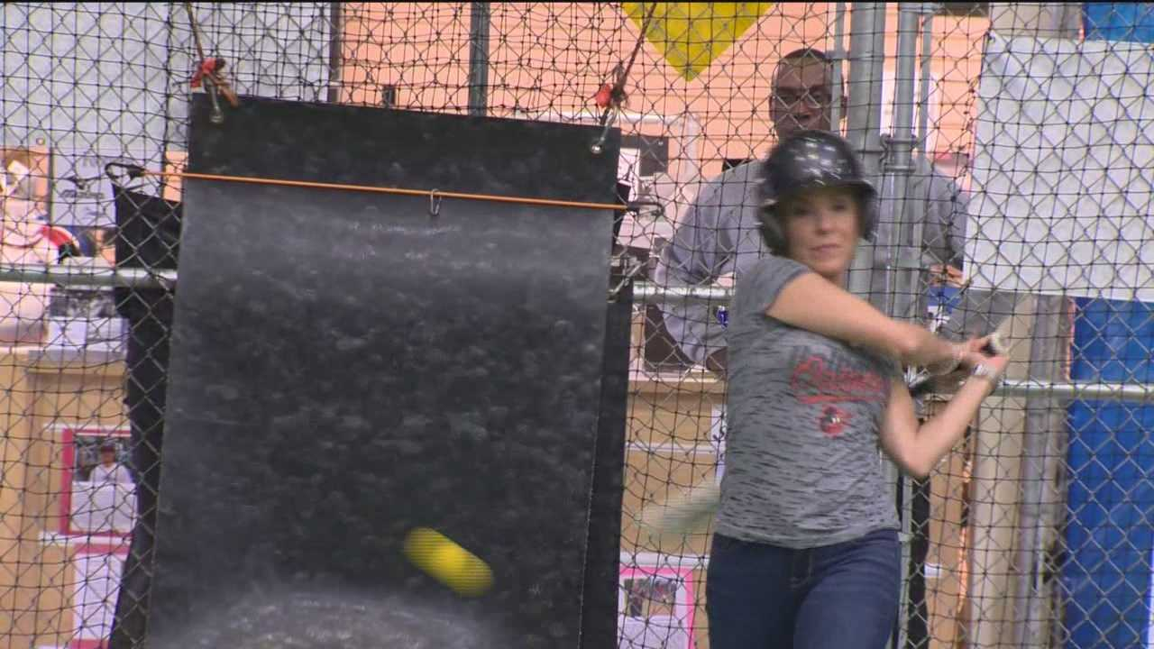 Mindy and Jason wanted to know, how hard could it be to hit home runs like the Orioles? So they went to Extra Innings batting cages in White Marsh to find out.