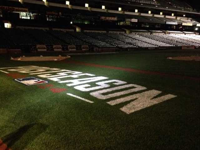 11 News' Jason Newton takes a photo of the field early Thursday morning during the live broadcast from Camden Yards.
