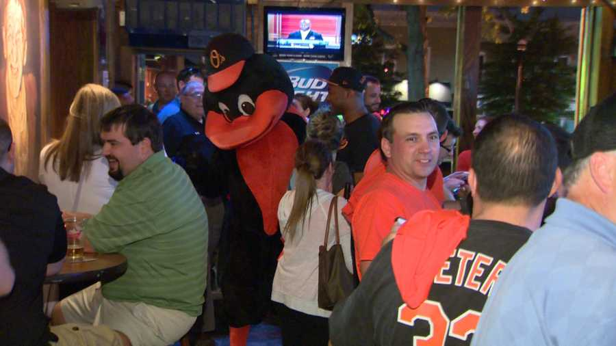 The Oriole Bird greets fans at Claddagh Pub in O'Donnell Square in Canton.