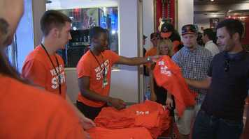 Earlier Wednesday, team reps gave out T-shirts to fans at the Hard Rock Cafe at the Inner Harbor.