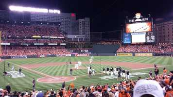 The Orioles take to the field after beating the Tigers in Game 1