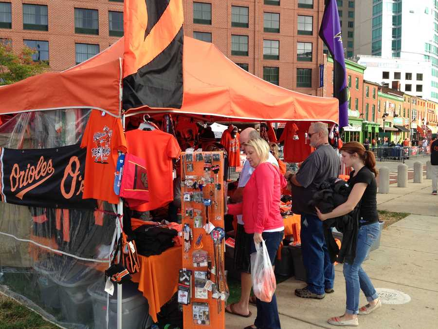 Vendors outside the stadium prepare for Game 2 of the ALDS as fans begin to filter in.