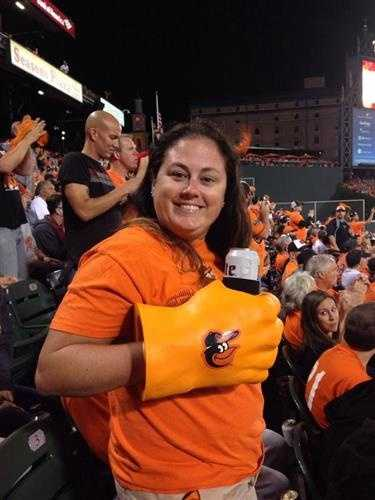 Liza Woltjen shows off a unique drinking accessory. Think of what the Incredible Hulk's clenched fist would look like painted orange.