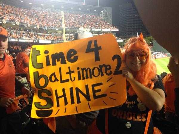 """Fans enthusiastically waved orange towels handed out at the gate. Homemade signs filled many sections of Oriole Park at Camden Yards as if ESPN's """"College Gameday"""" had set up shop. A creative collection of those signs resided in the left-field bleachers."""