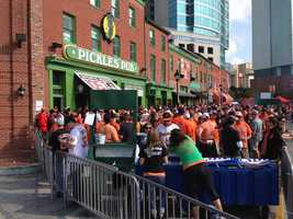 Fans crowd Pickles Pub outside the stadium early Friday.