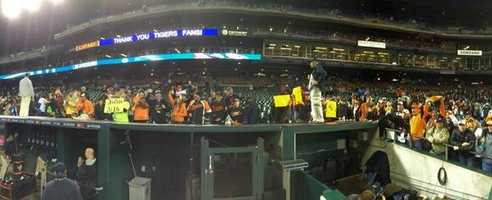 Orioles fans crowding the dugout in Detroit and celebrating with their Birdland heroes.