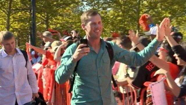 Brad Brach greets fans as he records the celebration on his phone.