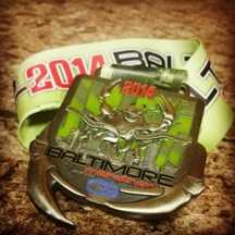 The 2014 Baltimore Running Festival medals also dub as a bottle opener.