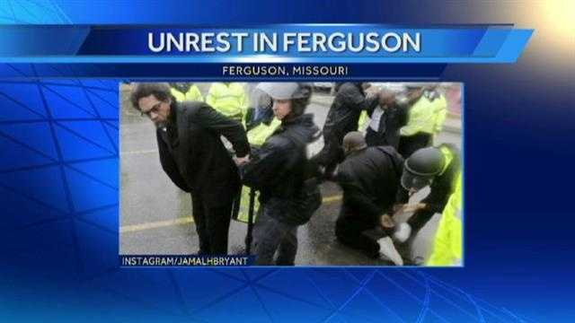 Dr. Cornell West (left) and the Rev. Jamal Bryant (right) get arrested during a protest in Ferguson, Missouri.